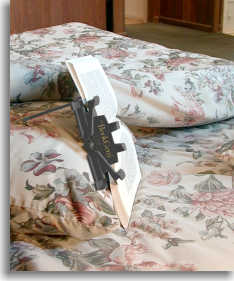 Fold the lower leg back in, and rest the upper leg on the pillow