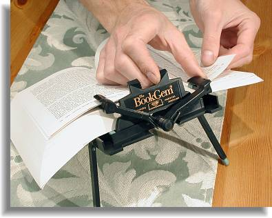 The book rest-thumb lever helps in lifing a page clip